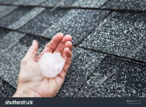 stock-photo-hail-in-hand-on-a-rooftop-after-hailstorm-720101785